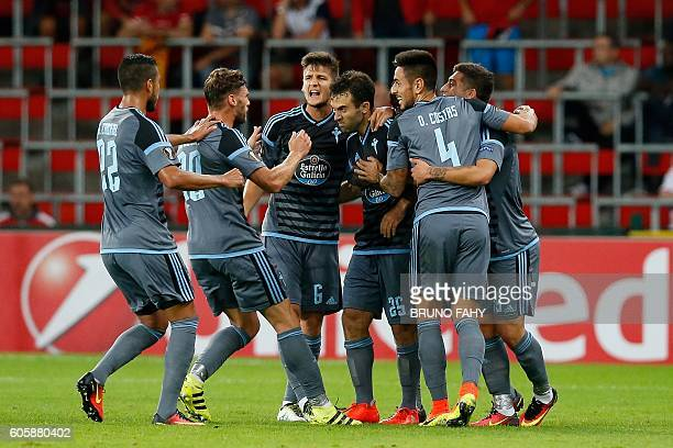 Celta's Giuseppe Rossi celebrates with his teammates after scoring during the UEFA Europa League group G football match between Standard de Liege and...