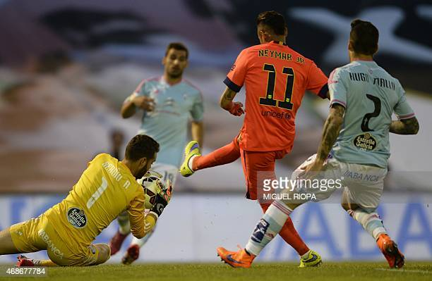 Celta's goalkeeper Sergio Alvarez stops the ball next to Barcelona's Brazilian forward Neymar da Silva Santos Junior during the Spanish league...