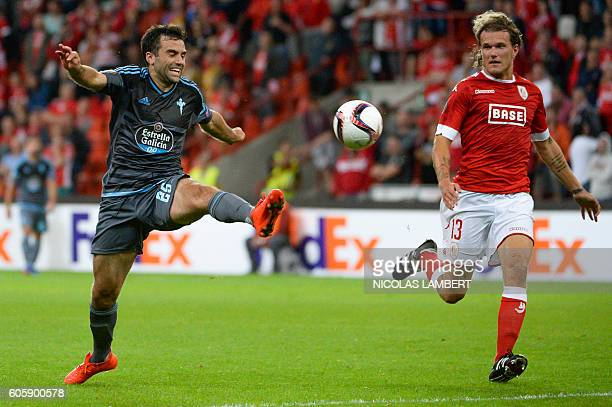 Celta's Italan forward Giuseppe Rossi vies with Standard's Danish defender Alexander Scholz during the Europa League group G football match between...