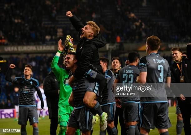 Celta's players celebrate after winning during the UEFA Europa League quarter final second leg football match KRC Genk against Celta Vigo at the...