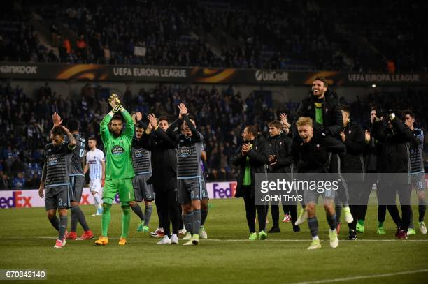Celta's players celebrate after winning the UEFA Europa League quarter final second leg football match KRC Genk against Celta Vigo at the Fenix...