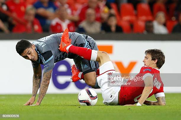 Celta's Spanish midfielder Pablo Hernandez and Standard's Belgian forward Benito Raman vie for the ball during the Europa League group G football...
