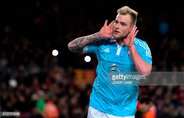 Celta's Swedish forward John Guidetti celebrates his goal during the Spanish league football match FC Barcelona vs RC Celta de Vigo at the Camp Nou...