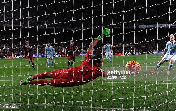 TOPSHOT Celta's Swedish forward John Guidetti scores a goal during the Spanish league football match FC Barcelona vs RC Celta de Vigo at the Camp Nou...