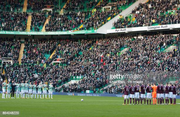 Celtic and Hearts players join in a minutes applause in memory of former Celtic player Sean Fallon during the Clydesdale Bank Scottish Premier League...