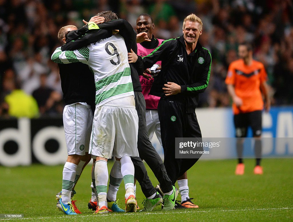 Celtic Assistant manager Johan Mjalby celebrates with the Celtic players at the final whistle during the UEFA Champions League Play Off Round Second Leg match between Celtic and FC Shakhter Karagandy at Celtic Park Stadium on August 28, 2013 in Glasgow, Scotland.
