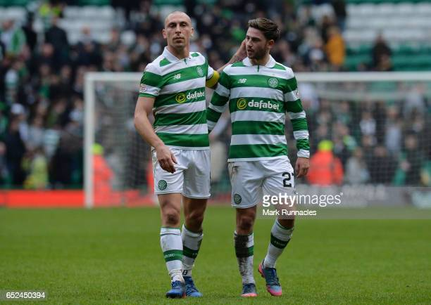 Celtic captain Scott Brown and Patrick Roberts at the final whistle during the Scottish Premiership match between Celtic FC and Rangers FC at Celtic...