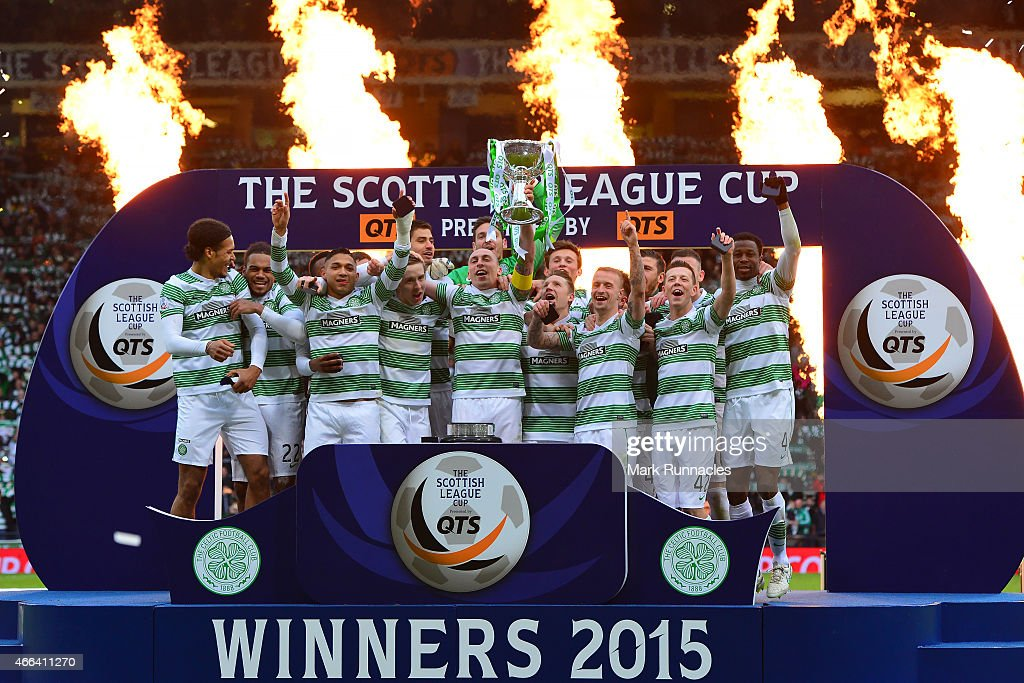 Celtic captain Scott Brown lifts the League Cup trophy as the Celtic team celebrate winning the Scottish League Cup Final between Dundee United and Celtic at Hamden Park on March 15, 2015 in Glasgow Scotland.