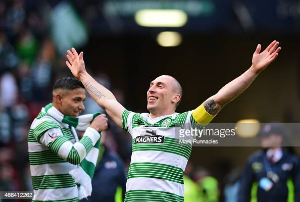 Celtic captain Scott Brown reacts as the Celtic team celebrate after winning the League Cup during the Scottish League Cup Final between Dundee...