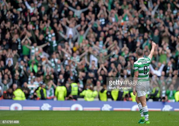 Celtic Captain Scott Brown receives applause from the Celtic fans as he walks from the pitch after being substituted late in the second half during...
