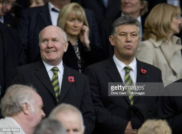 Celtic chairman John Reid and Celtic chief executive Peter Lawwell wearing poppies during the Clydesdale Bank Scottish Premier League match at Celtic...
