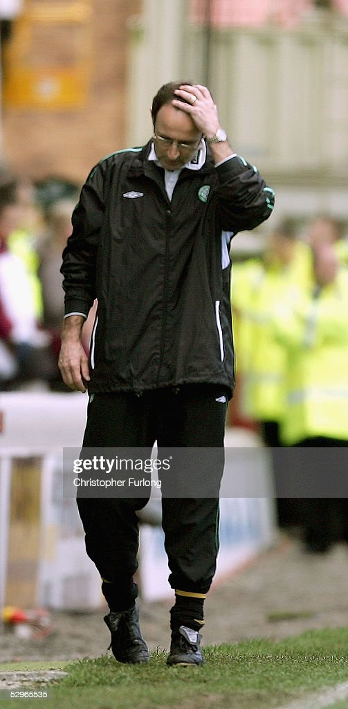 Celtic coach Martin O'Neill looks dejected as he sees Motherwell score two goals in the dying minutes denying Celtic the league title during the Scottish Premier League match between Motherwell and Celtic at Fir Park on May 22, 2005, Motherwell, Scotland.