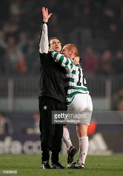 Celtic coach Martin O'Neill salues the Celtic fans while hugging Neil Lennon after the UEFA Champions League Group F match between FC Barcelona and...