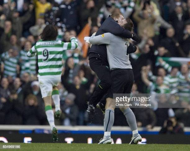 Celtic coach Neil Lennon leaps on Celtic goalkeeper Artur Boruc in celebration of Celtic's victory during the Clydesdale Bank Scottish Premier League...