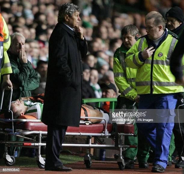 Celtic coach Tommy Burns looks on as John Kennedy is stretchered off during the UEFA Champions League match Celtic Park Glasgow
