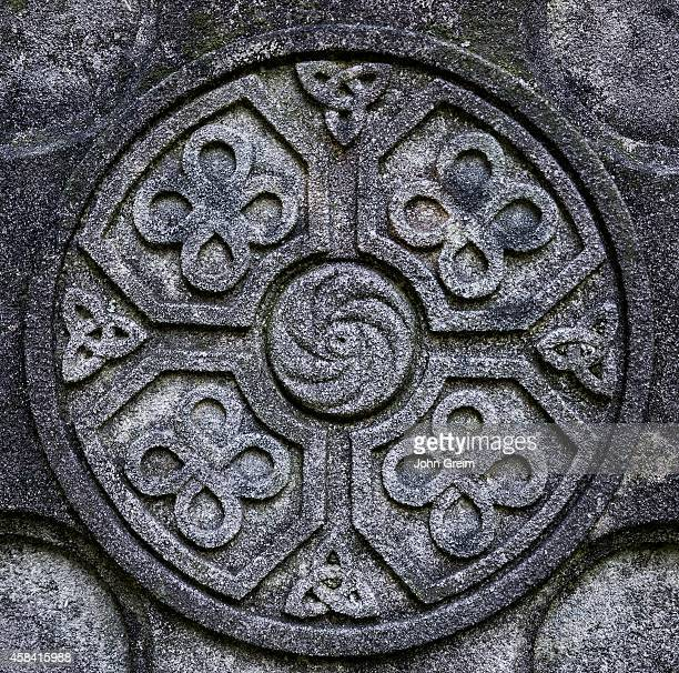 Celtic cross detail with knot symbol designs