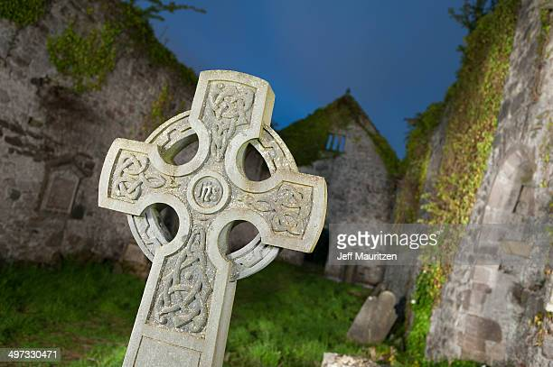 A Celtic cross in Killagha Priory at night, in Milltown.