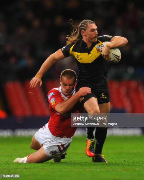 Celtic Crusaders' Jarrod Sammut is tackled by Salford City Reds' Daniel Holdsworth during the Engage Super League match at the Millennium Stadium...