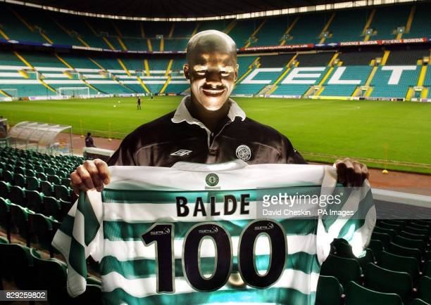 Celtic defender Bobo Balde at Celtic Park Glasgow with one of the 100 new club strips which he is to hand out in his home country of Guinea More than...