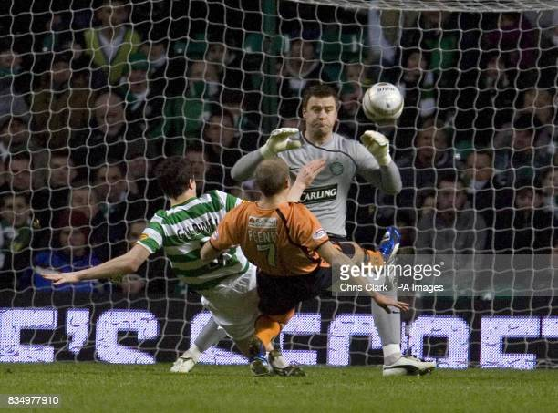 Celtic defender Gary Caldwell tries to tackle as Dundee United's Warren Feeney shoots past Celtic goalkeeper Artur Boruc to score the equalising goal...