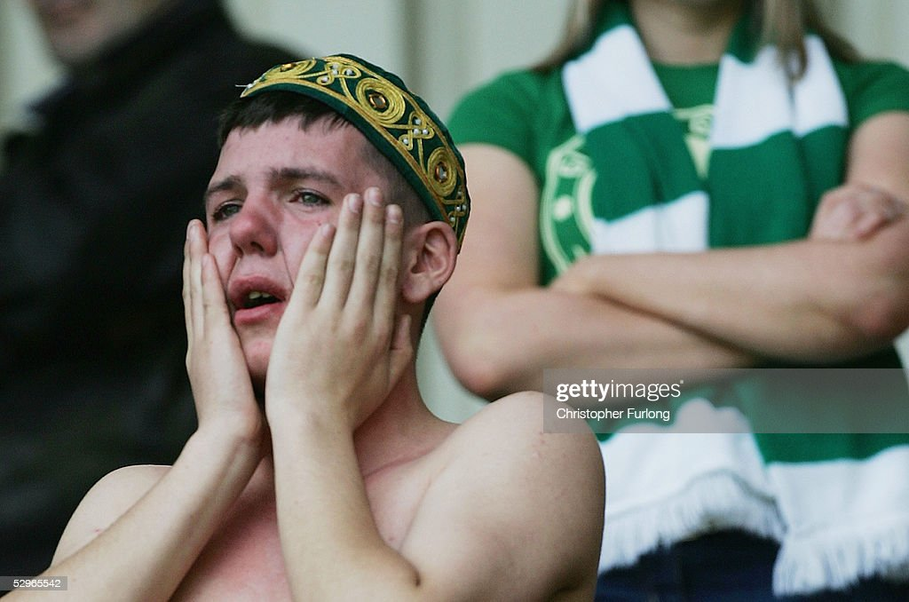 A Celtic fan crys after Celtic lost 2-1 to Motherwell resulting in their rivals Glasgow Rangers lifting the league title after the Scottish Premier League match between Motherwell and Celtic at Fir Park, on May 22, 2005 in Motherwell, Scotland.