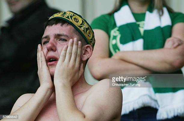 Celtic fan crys after Celtic lost 21 to Motherwell resulting in their rivals Glasgow Rangers lifting the league title after the Scottish Premier...