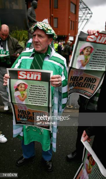 Celtic fan holds a poster of Madeleine McCann inside Celtic Park May 12 2007 in Glasgow Scotland The three year old went missing from a holiday...