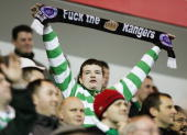 Celtic fan holds a scarf containing obscene wording during the CIS Insurance Cup fourth round between Celtic and Rangers at Ibrox on November 10 2004...