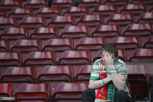 Celtic fan holds his head in his hands after Celtic lost 21 to Motherwell resulting in their rivals Glasgow Rangers lifting the league title after...