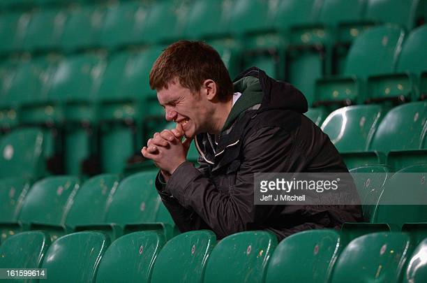 Celtic fan looks dejected at the end of the UEFA Champions League Round of 16 first leg match between Celtic and Juventus at Celtic Park Stadium on...
