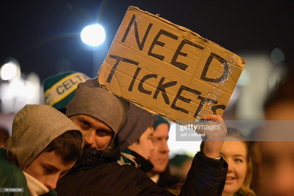 A Celtic fan looks for tickets prior to the UEFA Champions League Round of 16 first leg match between Celtic and Juventus at Celtic Park Stadium on February 12, 2013 in Glasgow, Scotland.
