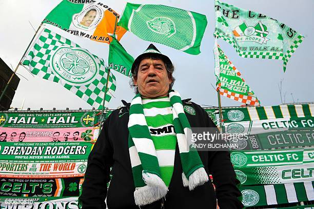 A Celtic fan stands in front of a stall at Celtic Park in Glasgow on December 17 2016 before the Scottish Premiership football match between Celtic...