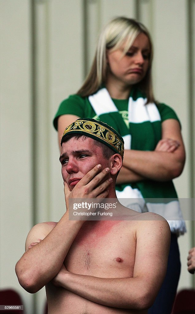 A Celtic fan weeps after Celtic lost 2-1 to Motherwell resulting in their rivals Glasgow Rangers lifting the league title, after the Scottish Premier League match between Motherwell and Celtic on May 22, 2005, at Fir Park, Motherwell, Scotland.
