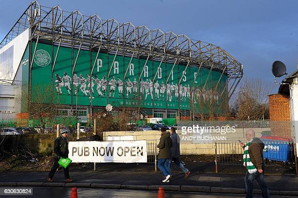 Celtic fans arrive at Celtic Park in Glasgow on December 17 2016 before the Scottish Premiership football match between Celtic and Dundee United The...