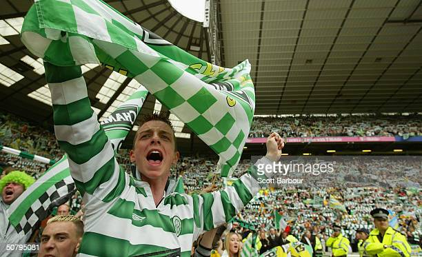 Celtic fans cheer during the Scottish Premier League match between Glasgow Celtic and Dunfermline Athletic played at Celtic Park on May 2 2004 in...