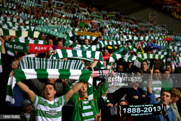 Celtic fans cheer on their team prior to kickoff during the UEFA Champions League Group H match between Celtic and Ajax at Celtic Park Stadium on...