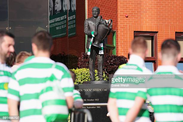 Celtic fans gather by the statue of former manager Jock Stein outside the ground prior to the UEFA Champions League Playoff First leg match between...
