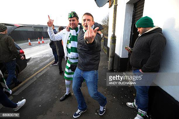 Celtic fans gesture outside Celtic Park in Glasgow on December 17 2016 before their Scottish Premiership football match against Dundee United The...