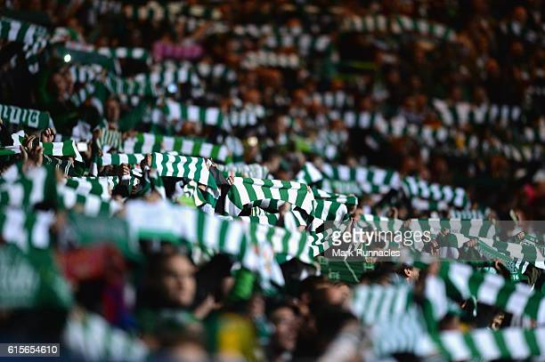 Celtic fans hold up scarves ahead of the UEFA Champions League group C match between Celtic FC and VfL Borussia Moenchengladbach at Celtic Park on...