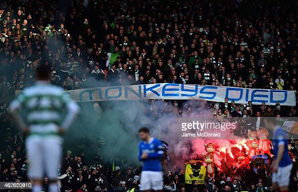 Celtic fans light flares and hold up inflatables during the Scottish League Cup SemiFinal between Celtic and Rangers at Hampden Park on February 1...