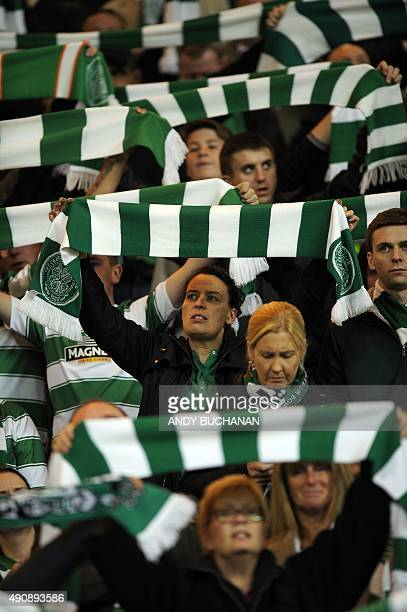 Celtic fans raise their scarves in the crowd before kick off in the UEFA Europa League group A football match between Celtic and Fenerbahce at Celtic...
