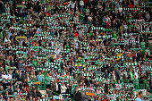 Celtic fans show their colours during the UEFA Champions League Third Qualifying Round First Leg match between Celtic and Elfsborg at Celtic Park...
