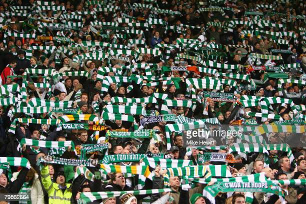 Celtic fans show their support during the UEFA Champions League First Knockout Round First Leg match between Celtic and Barcelona at Celtic Park on...