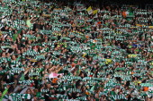 Celtic fans sing during the Clydesdale Bank Premier League match between Celtic and Rangers at Celtic Park on October 24 2010 in Glasgow Scotland