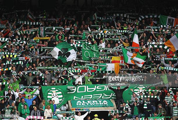 Celtic fans sing 'You'll never walk alone' at the end of the Clydesdale Bank Premier League match between Celtic and Motherwell at Celtic Park on May...