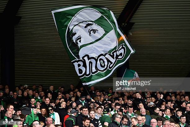 Celtic fans wave a flag ahead of the William Hill Scottish Cup semi final between Rangers and Celtic at Hampden Park on April 17 2016 in Glasgow...