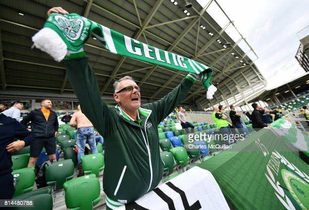 Celtic fans wave their scarves before the Champions League second round first leg qualifying game between Linfield and Celtic at Windsor Park on July...
