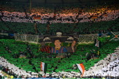 Celtic fans welcome the teams prior to the UEFA Champions League Group H match between Celtic and FC Barcelona at Celtic Park Stadium on October 1...