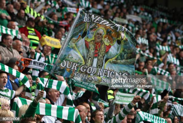 Celtic fans with banners and scarves observe a moments applause for the late Jock Stein during the Clydesdale Bank Scottish Premier League match at...