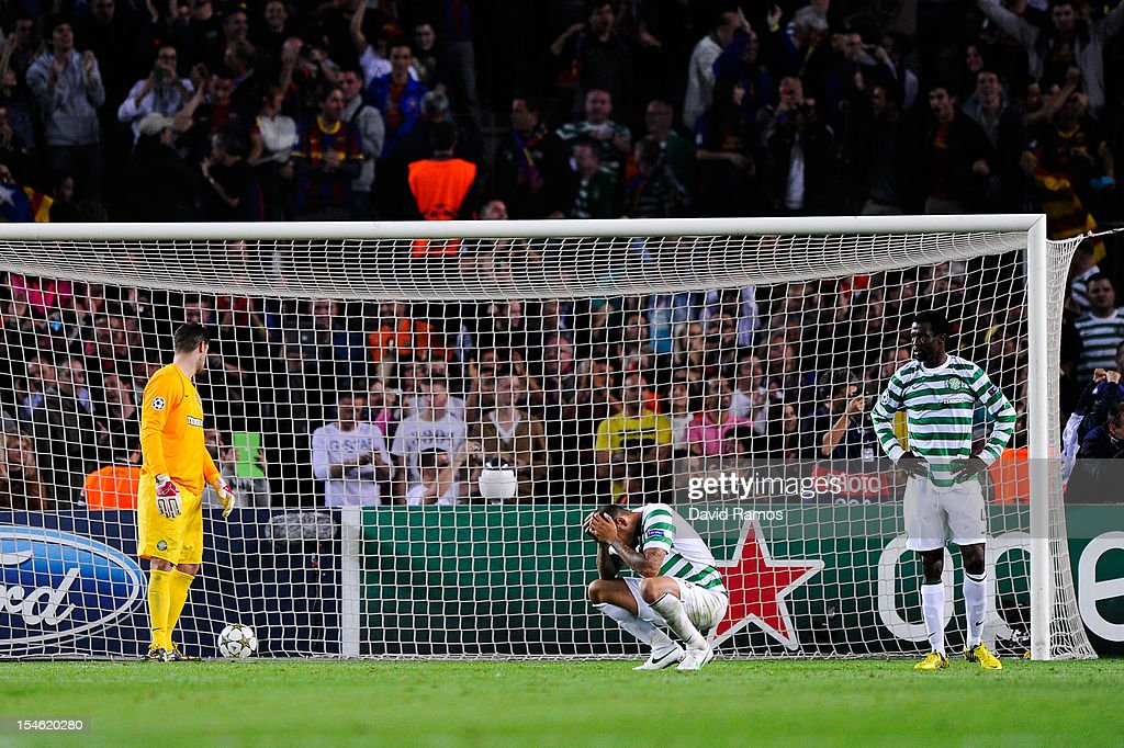 Celtic FC players look dejected after Jordi Alba of FC Barcelona after scored his team's winning goal during the UEFA Champions League Group G match between FC Barcelona and Celtic FC at the Camp Nou Stadium on October 23, 2012 in Barcelona, Spain. FC Barcelona won 2-1.